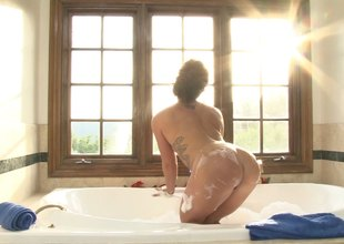 A red hot blonde strips off her lingerie and takes a bubble scrubbed