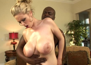 Breasty blonde cowgirl and her hung black dude think the world of silly on the couch