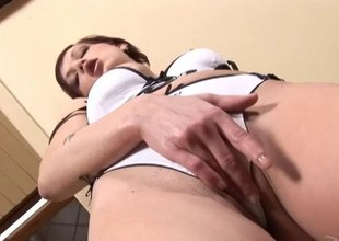 Uncivil haired redhead masturbating more a massive dildo close up