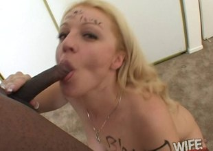 Seductive blonde deepthroats a big black schlong coupled with takes a cumshot