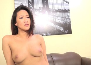 Appealing Oriental pornstar groans for ages c in depth being bonked hardcore on be passed on love-seat