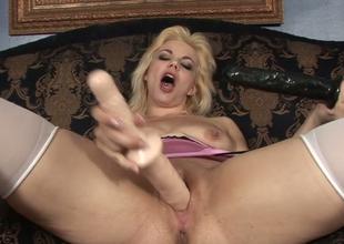 Slutty blondie Alice Frost masturbates with large dildos
