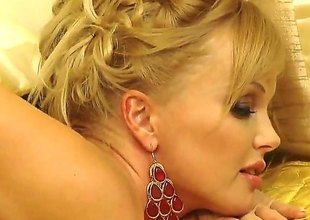 Blonde Silvia Saint does striptease in the lead she sticks her fingers in her love hole
