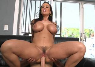 Lisa Ann is filmed as she rides a males dick like a cowgirl here