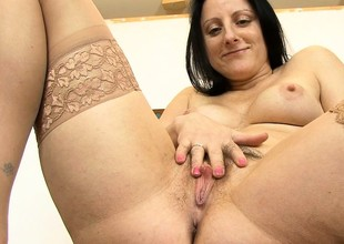 Chubby brunette MILF rubs their way hairy cunt with a toy wide their way office