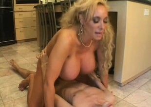 Huge, fake tit Milf puts on whip well-chosen onwards he drills her twat
