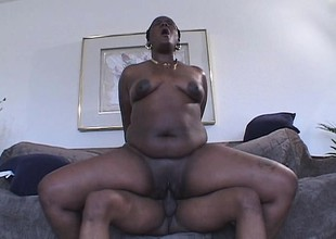 Black hoochie mama in high heels rides not susceptible a dick like a total champ
