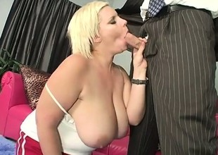 Inauspicious chubby slut gives a mean boob job surrounding her gigantic boobs