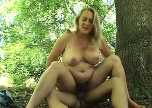 Naughty blonde can't wait for her boyfriend to nail her anent the woods