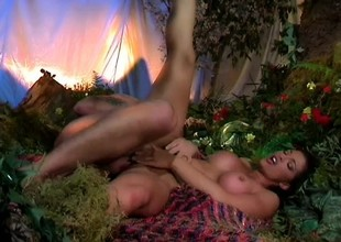 Recreating the garden with a hot brunette eating dong coupled with the apple