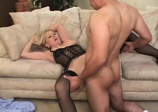 Breasty blonde cougar in darksome lingerie takes a young cock for a scenic route