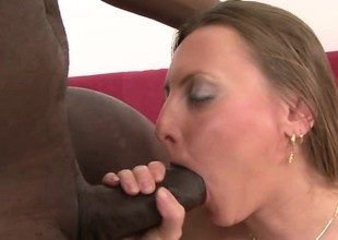 Thoughtless white MILF gets her pussy stirred by a massive dark cock