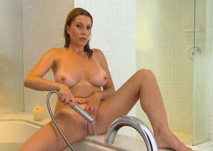 Hot, busty Milf is in the shower and using fingers and strongest wand on their way cunt