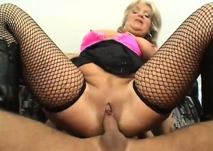 This granny likes them young she uses the brush big tits to suck his cock