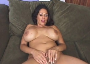 Saucy MILF with enormous breasts uses them to fuck a hung dude