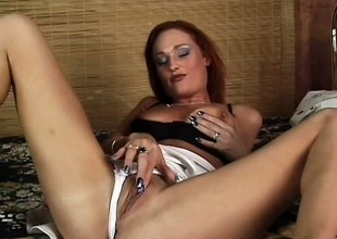 Aged redhead gets spanked unending whilst riding a awkward sausage