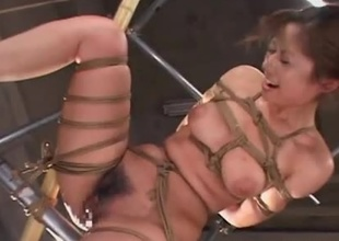 Sexy Japanese woman is rope fastened with her hands tied behind her. That babe straddles a vibrator and he gets her off endlessly. 2 men then enjoy her pleasure with multiple sex-toys placed all over her tits and pussy. That babe drools and orgasms multiple times.