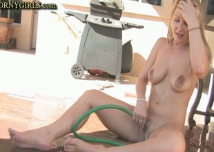 Stuffing A Waterhose In Her Pussy