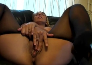 Large boobs amateur in pantyhose fingers her vagina