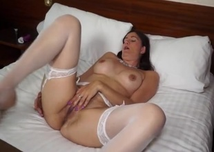 Nice-looking uninspired stockings on a masturbating milf