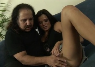 Ron Jeremy watches a slim cutie get unvarnished for him