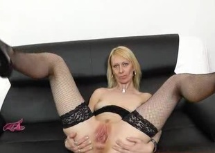 Staggering blonde Nelly spreads her legs once again