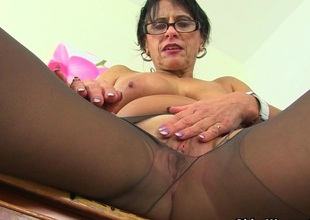 British milf Raven tweaks her tights for facile access
