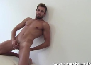 Charming gay guy with a beard masturbates