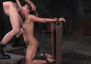Skinny tied girl gags on a locate nigh her throat