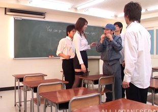 Red-hot hot Asian teacher keeps students after class to thing embrace