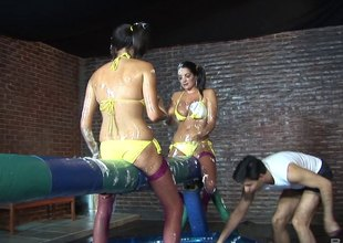 Babes in bikinis battle with batons in the past down an awesome orgy