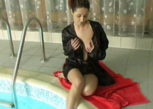 Satin robe beauty bares her tits and touches her sexy cunt