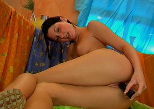Shaved teen mien spectacular in all directions a dildo in her wet cunt