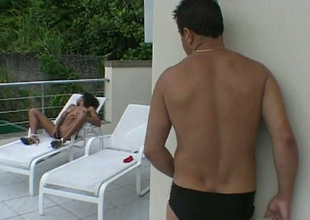 Curly svelte ebony nympho masturbates on deck chair and gives BJ