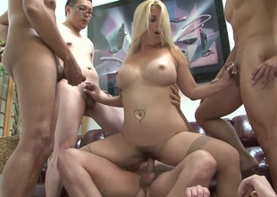 Tattooed cowgirl with broad in the beam tits acquires will not hear of slit gangbanged in hot group sex