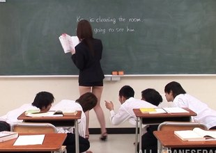 Teacher in a slutty skirt masturbates in front of the class