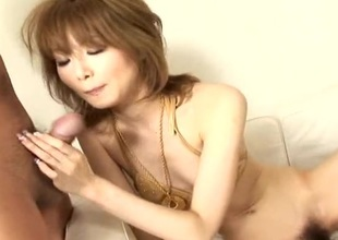 Asian cuttie in her golden bikini sucking a changeless horseshit