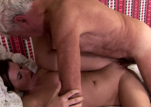Palatable brunette excessive price gets banged by a horny grand-dad