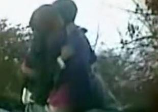 Voyeur tapes an asian couple having sex on rocks outside