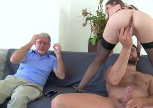 A brunette with small tits is getting rammed by a younger stud