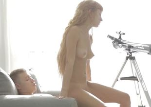 Fleshly riding redhead with a lean teen body