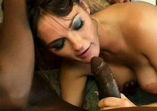 Impressive brunette not far from perfect tits gets nailed hard by two black guys