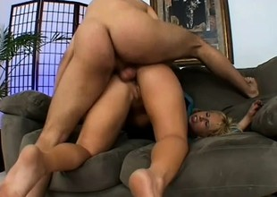 Irregular blonde in frowning stockings takes a firm locate in her ass and moans with delight