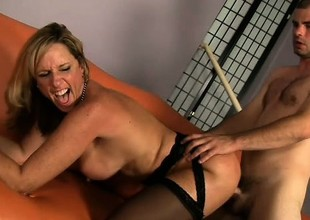 Sexually excited blonde cougar with large boobs Jodi West needs to get pounded deep and enduring