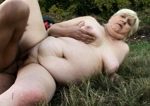 Chubby granny gets slammed outdoors by a freaky youthful devil's pecker