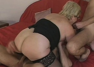 Lusty grandma acquires spit roasted hard by 2 horny young stallions