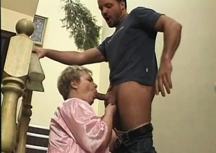 Big patriarch lady fervorously fucks a young stud's dick primarily eradicate affect stairs