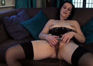 She tries to make her grown up body look sexy in lingerie and plays with her hairy space