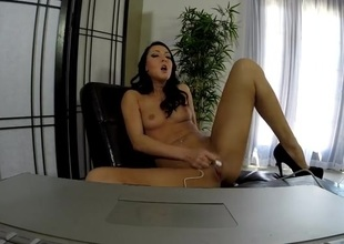High heels playgirl in front of her computer with toys
