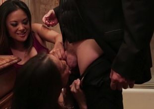 Kaylani Lei and Kalina Ryu suck cock in the go to the bathroom
